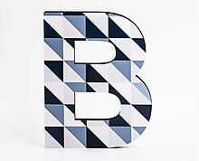 wood letter B with blue diagonal squares